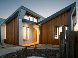 Raked roof, clestory windows shape light at Northcote Solar Home by Green Sheep Collective