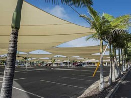 Dimensionally stable architectural fabrics achieving safe tensile structures