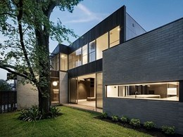 Stained cedar and Ash Grey brick tiles add warmth, texture to Melbourne townhouse