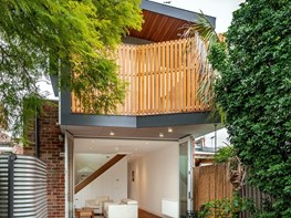 Renovated terrace house with garden views and passive solar design