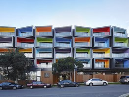 Multi-coloured stacked apartments embody multicultural Melbourne suburb