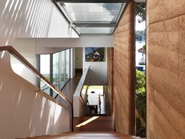 A self-cooling stairwell & rammed earth walls in Luigi Rosselli's textural Kirribilli residence