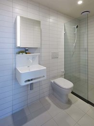 Vision basins customised in solid surface white for Melbourne luxury apartments