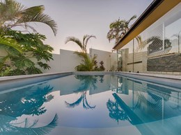 Modern pool fence for Aussie homes with SlimWall and aluminium posts