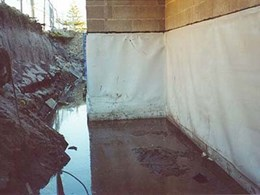 Retaining walls below water table waterproofed with Cosmofin membrane system