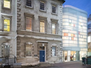 The building features a softened, translucent exterior in the day, which lights up like a lantern at night. Photography: Iwan Baan for Steven Holl Architects