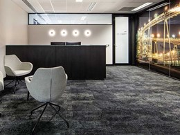Custom carpet created with gold accent for gold mining company's office