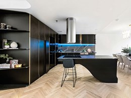 Herringbone flooring unifies distinctive spaces in Melbourne penthouse