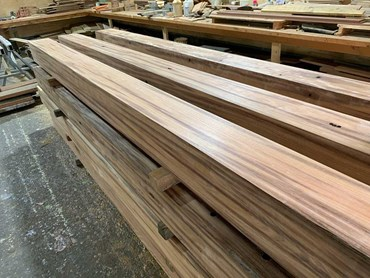 Planks from timber power poles