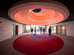 Quakers Centre in Melbourne features shifting circular worship space with skylight
