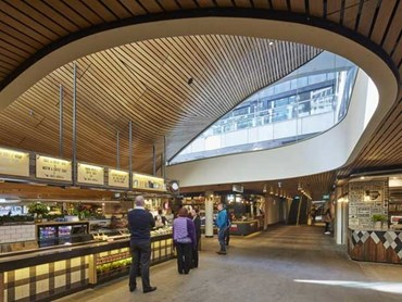SUPASLAT slatted timber ceiling panels achieve an undulating curved effect on the ceiling throughout the Food Court